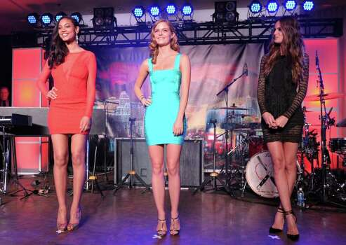 (L-R) SI swimsuit models Ariel Meredith, Jessica Perez and Izabel Goulart onstage at Club SI Swimsuit hosted by the Pure Nightclub at Caesars Palace at the Pure Nightclub at Caesars Palace on February 16, 2012 in Las Vegas, Nevada. Photo: Michael Loccisano, Getty Images / 2010 Getty Images
