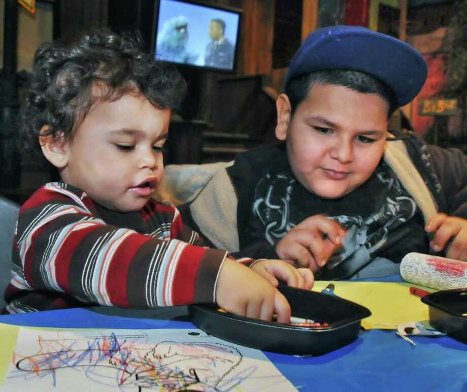 """2-year-old Ralphy Rivera, left, and 7-year-old Willim Mercado (both of Albany) draw their favorite characters during """"Sunny Days on Sesame Street""""  one of the winter break activities at the NYS tate Museum at the Empire State Plaza in Albany Tuesday afternoon February 16, 2010.   (John Carl D'Annibale / Times Union) Photo: John Carl D'Annibale / 00007464A"""