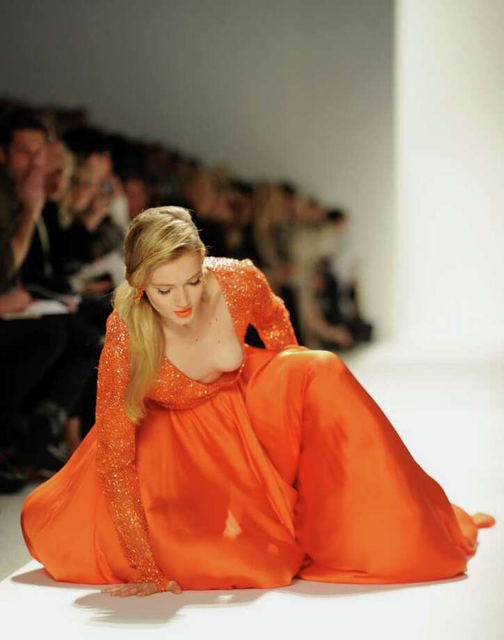 A model slips on the runway during the Dennis Basso show February 14, 2012 at Mercedes Benz Fashion Week in New York. AFP PHOTO/Stan HONDA Photo: STAN HONDA, AFP/Getty Images / AFP