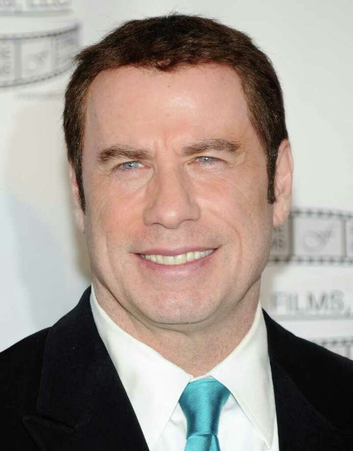 John Travolta is at odds with a massage parlor over some recent accusations.  Photo: Evan Agostini / AP2011
