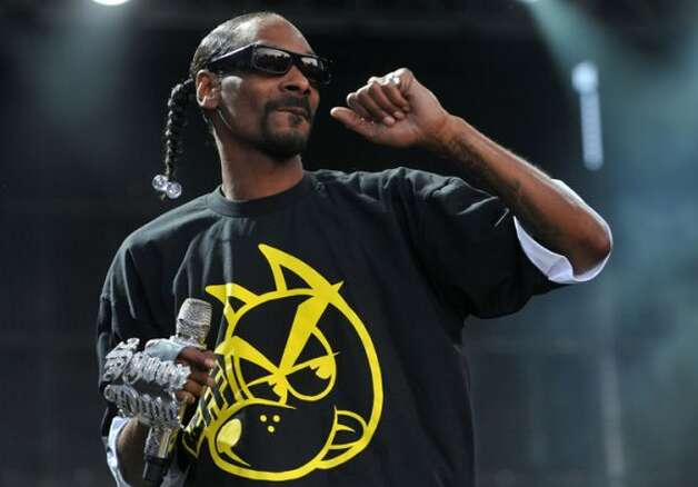"Snoop Dogg (Snoop Lion?) says he's voting for Obama. Snoop listed his reasons for disliking Romney online: ""This (expletive)'s name is Mitt"" and ""he reminds me of every boss I ever hated.""  (Tamas Kovacs / AP)"