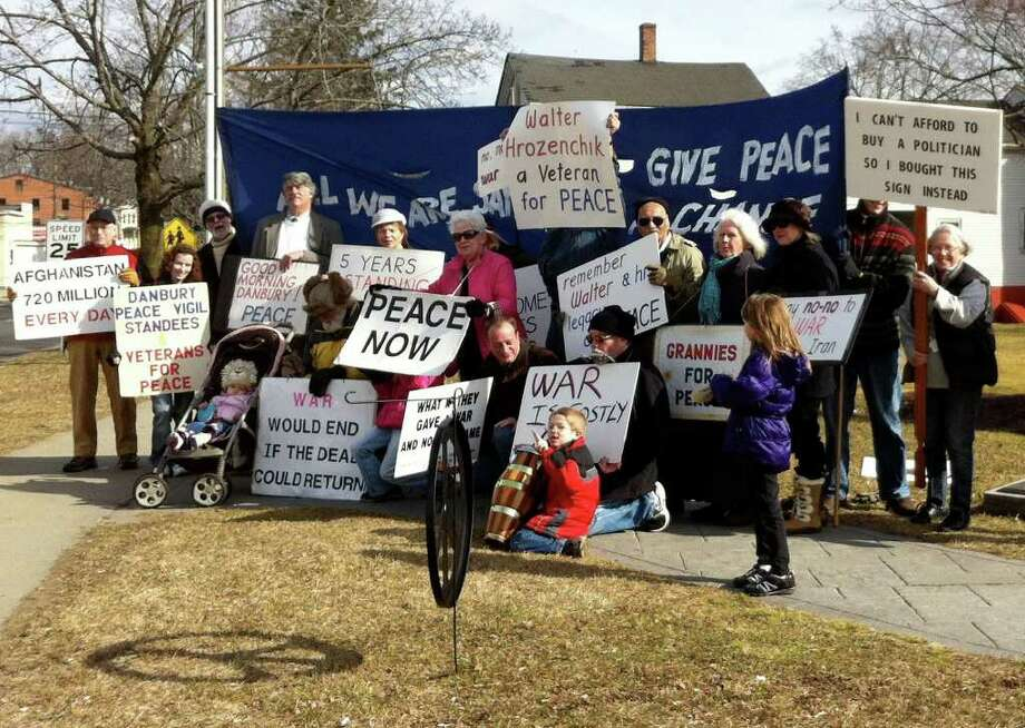The Standees for Peace have been gathering every Saturday morning for five years in front of the War Memorial in Danbury. The vigil on Feb. 4 included a tribute to Walter Hrozenchik, a member who died earlier that week Photo: Contributed Photo