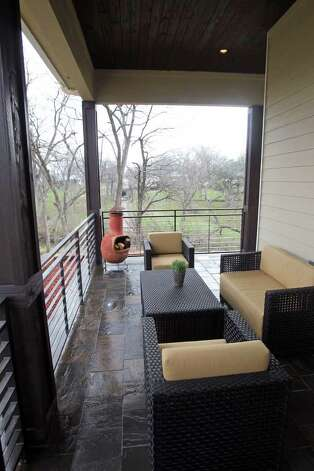 The porch wraps around the home of Bradley and Terrilyn Crowley. Photo: TOM REEL, San Antonio Express-News / San Antonio Express-News