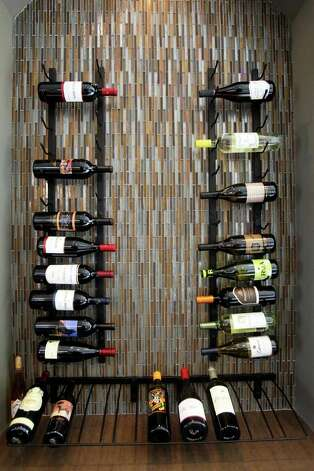 A wine rack in kitchen. Photo: TOM REEL, San Antonio Express-News / San Antonio Express-News