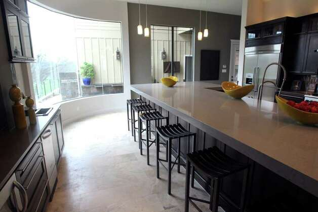 The breakfast bar in the kitchen. Photo: TOM REEL, San Antonio Express-News / San Antonio Express-News