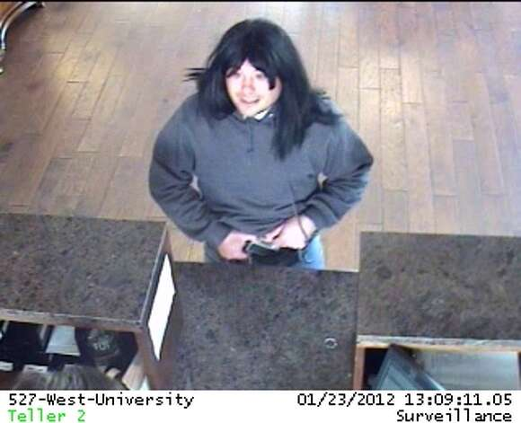 Bad Wig Bandit: A suspect in the Jan. 23 Prosperity Bank robbery in Houston wore a black, long-haired woman's wig during the robbery. He is still on the loose. Photo: FBI