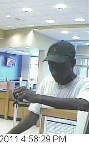 Wedding Band Bandit: A suspect in the Oct. 25, 2011 Capital One Bank robbery in Houston. The man s wedding band was very visible in the bank surveillance photos taken during the robbery. He was captured thanks to a tipster. Photo: FBI