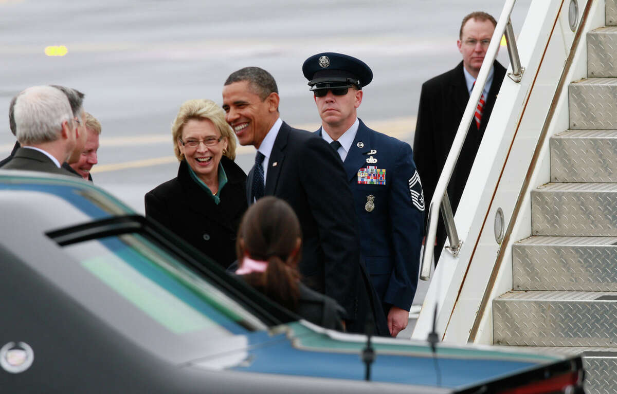President Barack Obama greets Governor Chris Gregoire, left middle, Seattle Mayor Mike McGinn, far left, white hair, and other city officials as he exits Air Force One at Boeing's Paine Field in Everett on Friday, Feb. 17, 2012. After landing, Obama plans to tour the Boeing facilities and will discuss foreign trade, manufacturing and the economy. Obama is also set to hold two fundraisers on the Eastside, with tickets starting at $17,900 for a private luncheon at the home of Costco executive Jeff Brotman, and $1,000 for a larger reception at the Bellevue Westin. The Seattle area is part of the President's 3-day trip to Wisconsin, California and finally Washington.