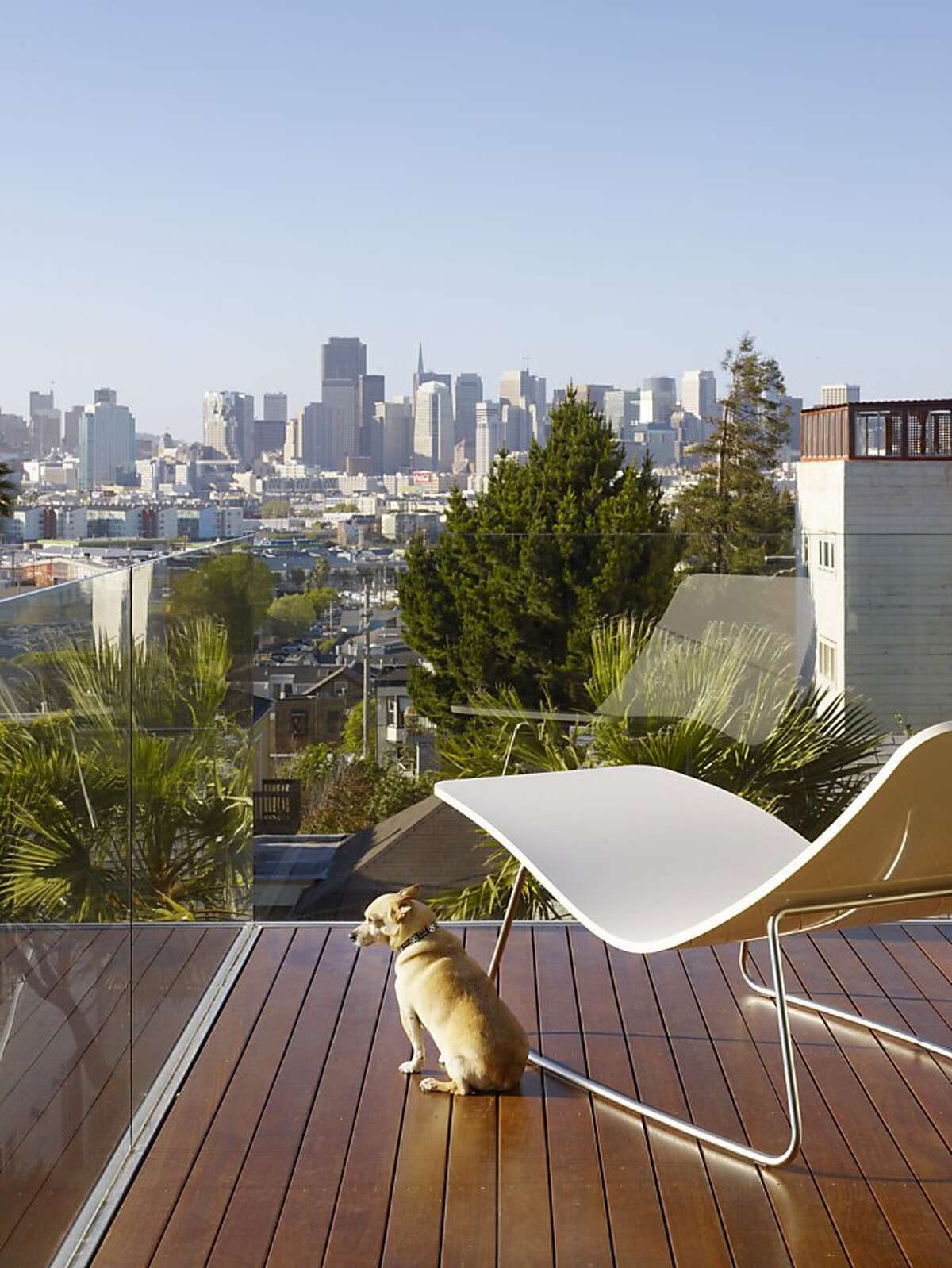 The kitchen balcony offers views of the San Francisco skyline.