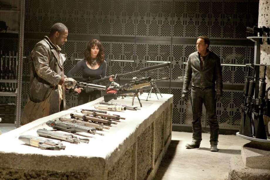 Egon Endrenyi/Columbia Pictures Idris Elba, Violante Placido, Nicolas Cage  Moreau leads Blaze and Nadya to the weapons room at the Sanctuary, where they arm themselves for their battle to retrieve Danny from Roarke--before it is too late in Columbia Pictures' action horror GHOSTRIDER SPIRIT OF VENGEANCE. Photo: Egon Endrenyi / © 2011 Columbia Pictures Industries, Inc. All Rights Reserved.  ALL IMAGES ARE PROPERTY OF SONY PICTURES ENTERTAINMENT INC. FOR PROMOTIONAL USE ONLY. SALE, DUPLICATION OR TRANSFER OF THIS MATERIAL IS STRICTLY PROHIBITED.