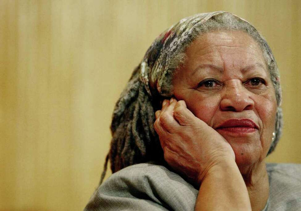 Nobel Prize laureate Toni Morrison listens to Mexico's Carlos Monsivais during the Julio Cortazar professorship conference at Guadalajara University Nov. 25 2005, in Guadalajara City, Mexico. A party for the author drew stars such as former President Bill Clinton and actor Morgan Freeman as well as officials and students from Princeton University where the author has taught for 17 years before announcing her retirement in spring 2006. (AP Photo/Guillermo Arias)