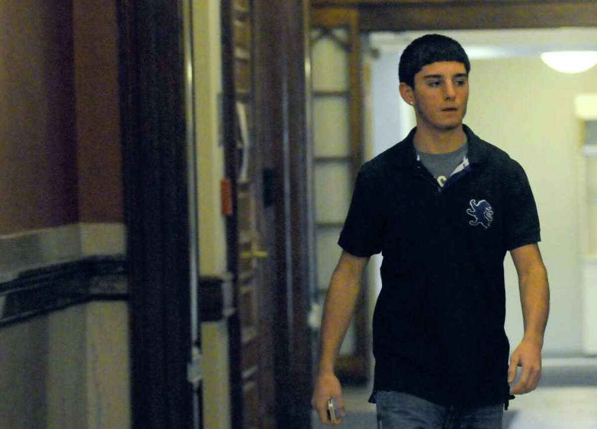 Vincent Uzzo, Troy High student, enters Rensselaer County Court in Troy, N.Y. Friday Feb.17, 2012. ( Michael P. Farrell/Times Union)