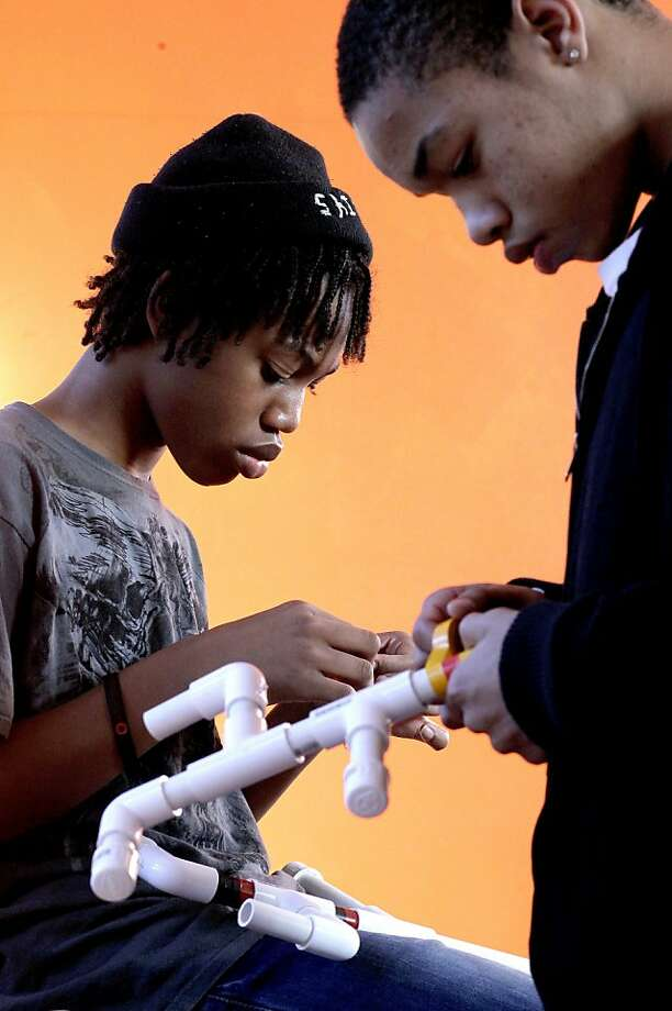 "Hasheim Thomas, (left) and Deante Miller work on their marshmellow guys during a hands-on program called ""Make @ Mack"", at the newly opened McClymond's Youth and Family Center in Oakland, Ca.  McClymond's High School has opened a new community center offering one-stop shopping for students and families including health care, job searching and parenting classes to name a few. Photo: Michael Macor, SFC"