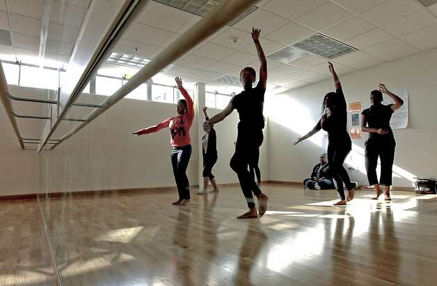 A beginning dance class, at the newly opened McClymond's Youth and Family Center in Oakland, Ca. McClymond's High School has opened a new community center offering one-stop shopping for students and families including health care, job searching and parenting classes to name a few. Photo: Michael Macor, SFC