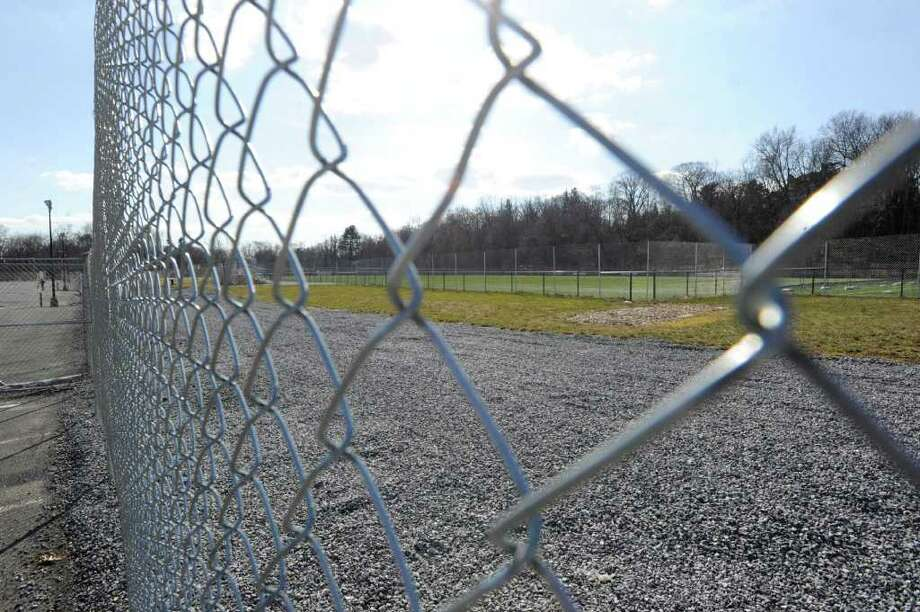 A view of the western athletic fields through a chain link fence at Greenwich High School Friday Feb. 17, 2012. Toxins discovered in the soil on school property during 2011 have stalled the auditorium project at the school. Photo: Bob Luckey / Greenwich Time