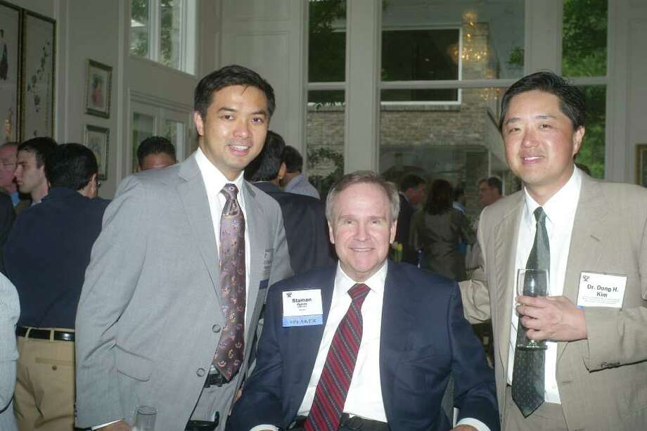 Staman Ogilvie, center, launched a rehab and research fund to assist his doctors at TIRR, including Gerard Francisco, left, and Dong Kim. Photo: Memorial Hermann Foundation