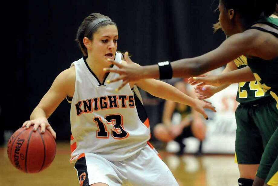 Stamford's Kelsey Cognetta controls the ball during the girls basketball game at Stamford High School on Friday, January 6, 2012. Photo: Lindsay Niegelberg / Stamford Advocate