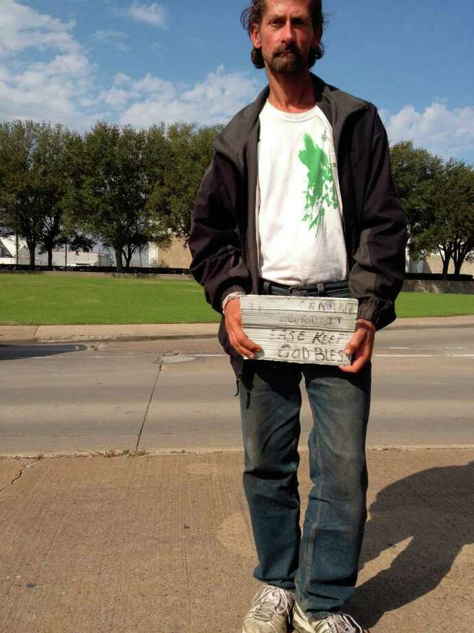 A panhandler looks for handouts near the University of Houston main campus. Photo: Sarah Tressler