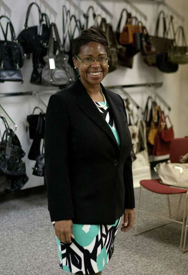 Dress for Success client Paula Whitfield while choosing an outfit at the Dress For Success' offices Monday, Jan. 23, 2012, in Houston.  ( James Nielsen / Chronicle ) Photo: James Nielsen / © 2011 Houston Chronicle
