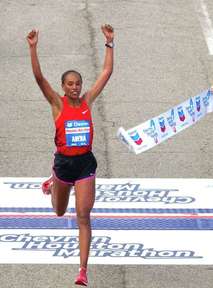 Alemitu Abera of Ethiopia wins the women's Chevron Houston Marathon in January. The event is recognized internationally in the running world. Photo: Cody Duty / © 2011 Houston Chronicle