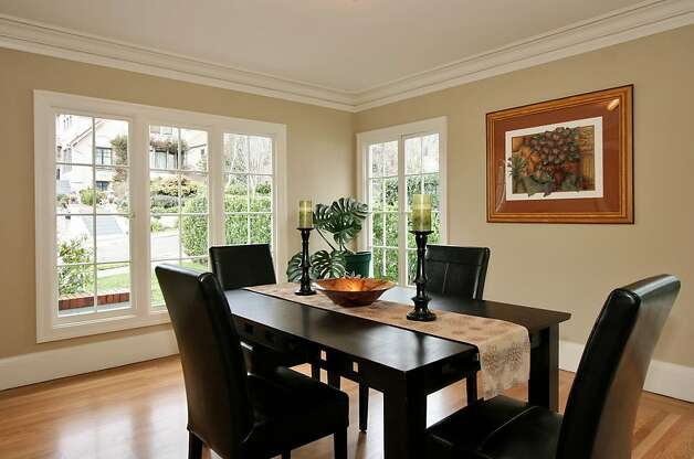 With its wide, open entries to both the front hall and kitchen, the formal dining room feels quite spacious. Photo: Liz Rusby