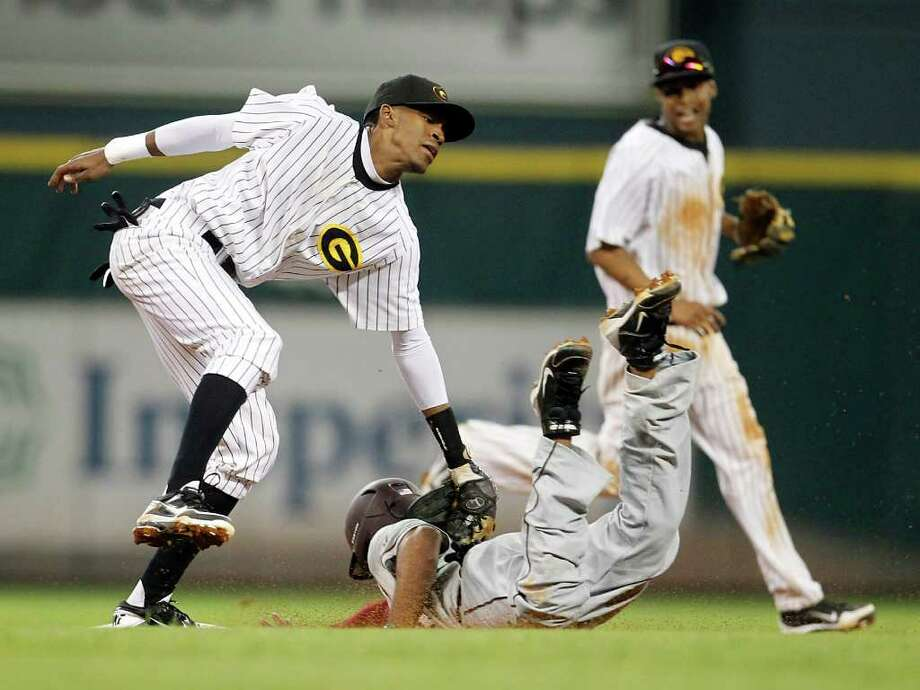 Grambling's Elias Todman (7) tags out TSU's Jag Gordaya (9) during the fourthinning of a college baseball game during the Urban Invitational at Minute Maid Park on Friday, Feb. 17, 2012. Photo: Karen Warren, Houston Chronicle / © 2012  Houston Chronicle