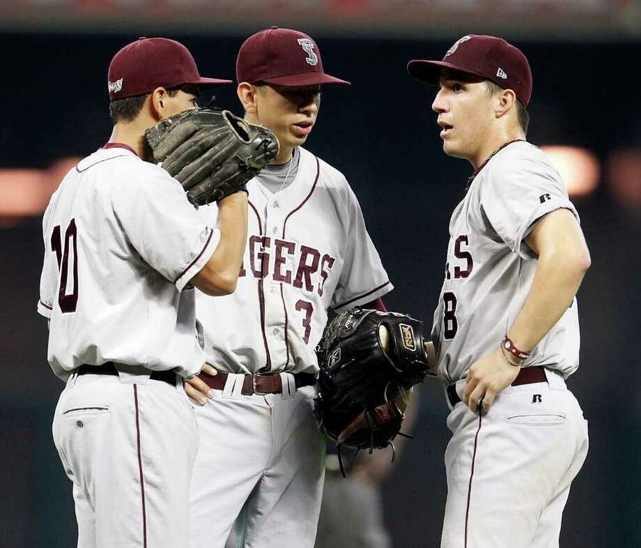Texas Southern University's Christopher De Leon (10, left) chats with Ray Hernandez (3, center) and Abel Flores (8, right) on the mound during the 2nd inning of a college baseball game during the Urban Invitational at Minute Maid Park on Friday, Feb. 17, 2012. Photo: Karen Warren, Houston Chronicle / © 2012  Houston Chronicle