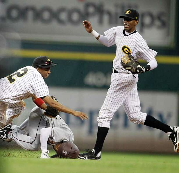 Grambling's Chris Wolfe (12) attempts to complete the double play on TSU's Corbin Smith (21) who mad