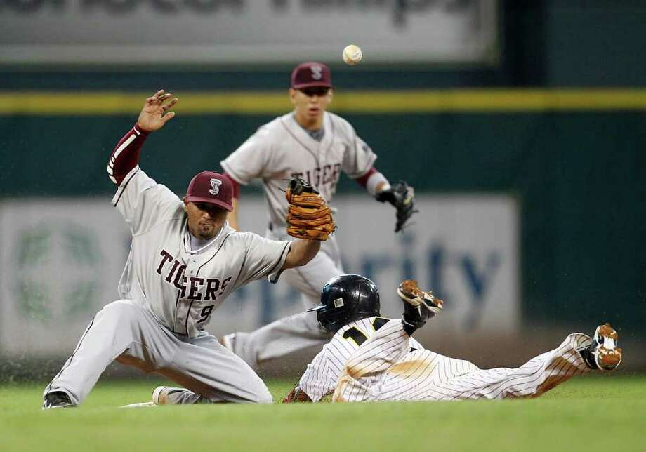 Texas Southern 6, Grambling State 5 - Texas Southern's Jag Gordaya (9) misses tagging out Grambling's Chris Wolfe (12) on a throwing error during the third inning of Friday's game at Minute Maid Park. Photo: Karen Warren, Houston Chronicle / © 2012  Houston Chronicle