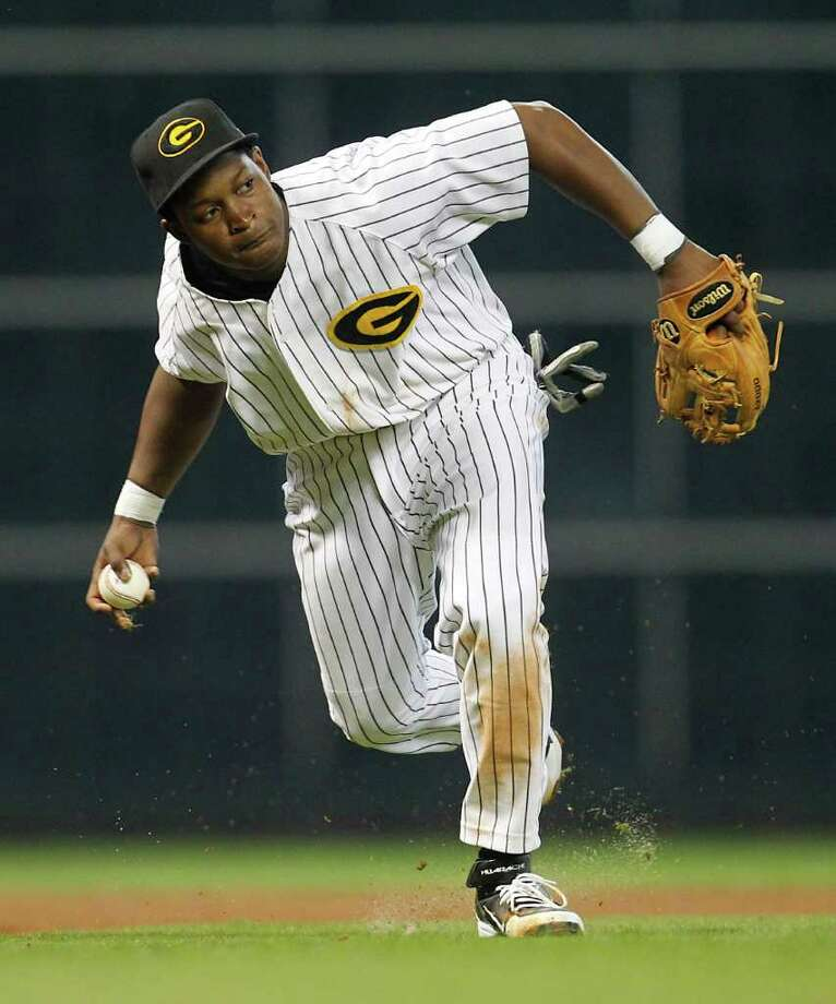 Grambling's third baseman Thomas Brown III (19) makes the throw to first base on a ground out by TSU's Cameron Logan (27) during the third inning of a college baseball game during the Urban Invitational at Minute Maid Park on Friday, Feb. 17, 2012. Photo: Karen Warren, Houston Chronicle / © 2012  Houston Chronicle