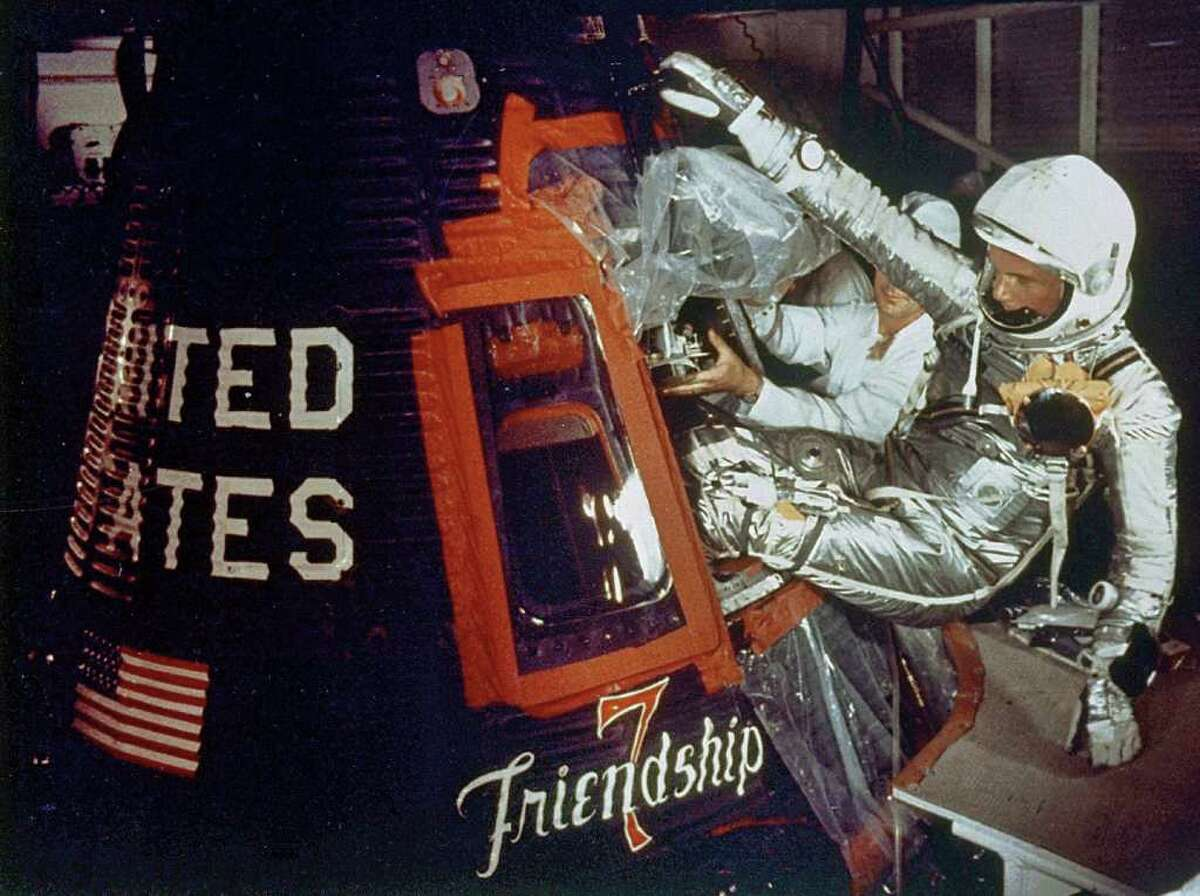 John Glenn climbs into the Friendship 7 space capsule on Feb. 20, 1962. After 10 delays, he blasted off atop an Atlas rocket at Cape Canaveral, Fla., for the flight that made him the first American to orbit the Earth.