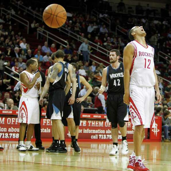 Rockets Kevin Martin (12) reacts after missing the technical foul  during the first half at an NBA b
