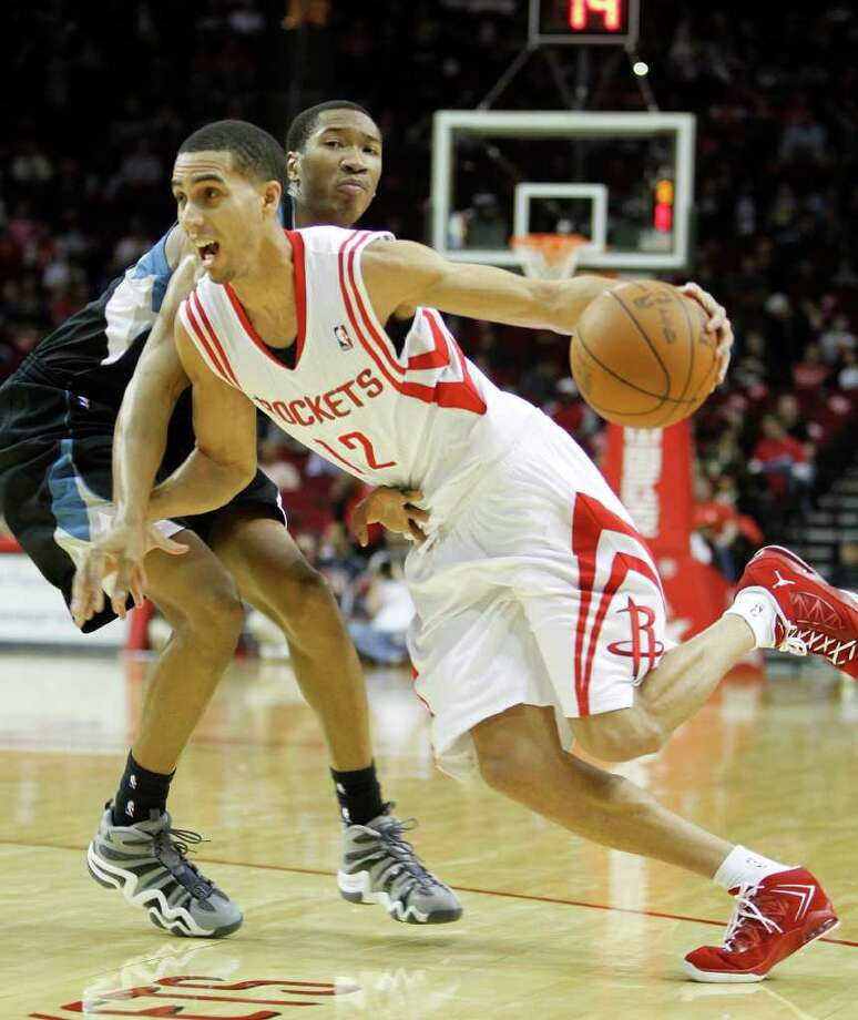 Rockets Kevin Martin (12) runs around Minnesota's Wesley Johnson (4) during the first half at an NBA basketball game at Toyota Center on Friday, Feb. 17, 2012. Photo: Karen Warren, Houston Chronicle / © 2012  Houston Chronicle