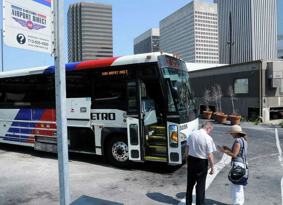 Metro bus driver Ronald Speagle answers a question for a rider about Metro's Airport Direct bus service before heading to George Bush  Intercontinental Airport from downtown Houston on June 2, 2011. Photo: Dave Rossman, For The Chronicle / 2011 Dave Rossman