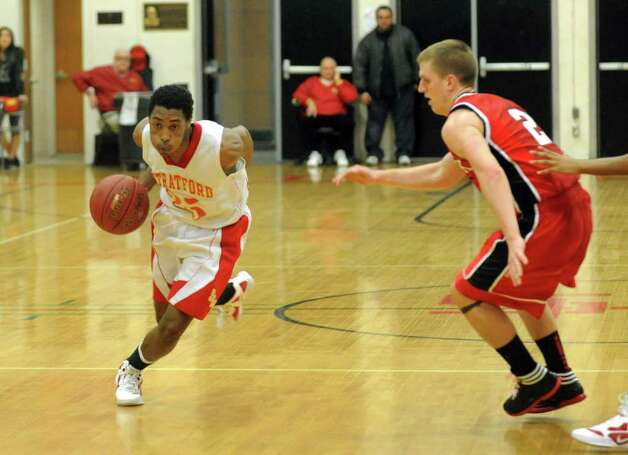 Stratford's Bernard Brantley, left, during boys basketball action against Masuk in Straford, Conn. on Friday February 17, 2012. Photo: Christian Abraham / Connecticut Post