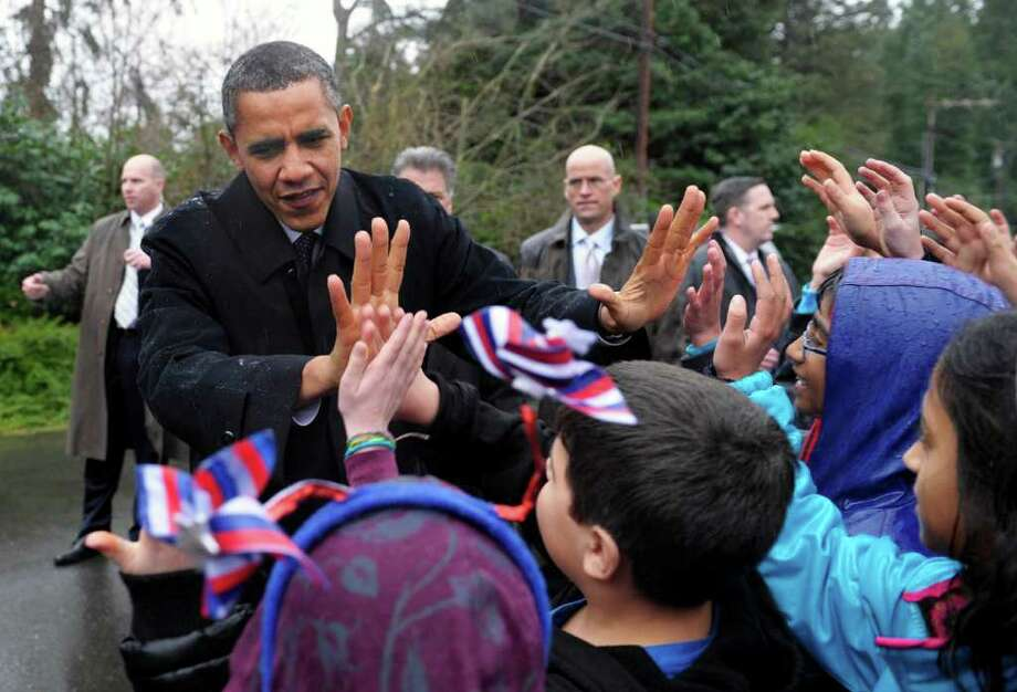 President Obama greets school children at Medina Elementary School.  The densest concentration of Democrats is in Seattle, but the densest place for donors is on the Eastside. Photo: AP