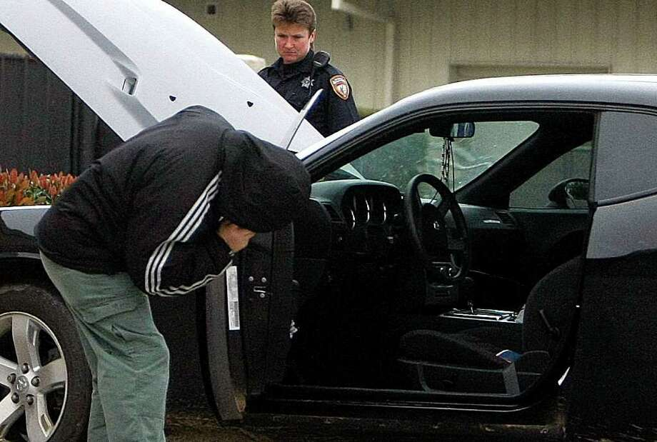 Police look for telltale signs that someone is hiding illegal drugs during a traffic stop. Click through to see a few of the things officers look for. Photo: Johnny Hanson, Houston Chronicle / © 2012  Houston Chronicle
