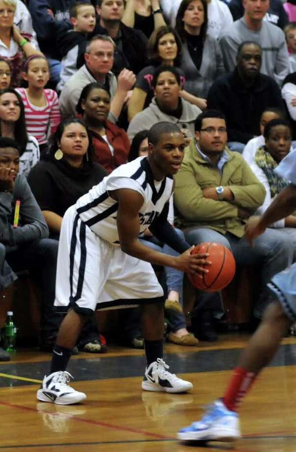 Immaculates, Dan McCorkle, has possession of the ball during a game at Immaculate againt Kolbe Cathedral on Friday night Feb. 17, 2012. Photo: Lisa Weir / The News-Times Freelance