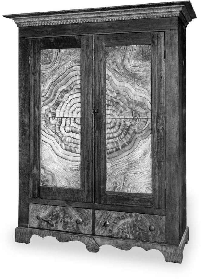 This cedar wardrobe was made in Texas in 1860, but the maker is unknown. It was possibly decorated by Matthias Melchior. The owner lives in Round Top. / Courtesy of the University of Te