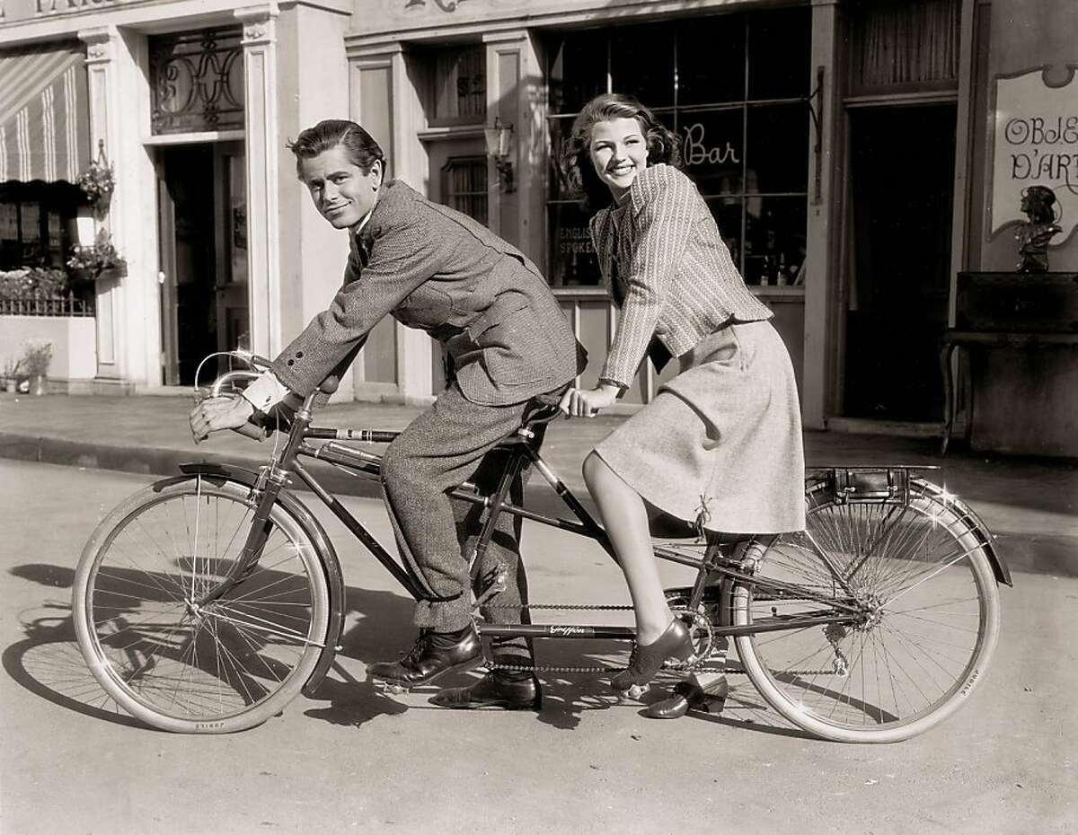 """Glenn Ford and Rita Hayworth from Steven Rea's book """"Hollywood Rides a Bike: Cycling With the Stars."""""""