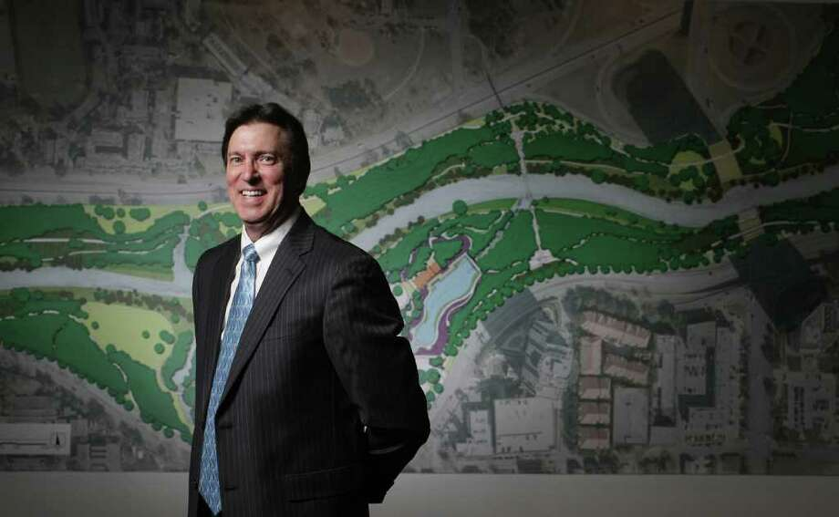 Perry Seeberger, Houston chapter president for the American Institute of Architects, displays plans for Buffalo Bayou Park. The plans are part of the Houston 20/20 Visions: Ten Years to Clarity exhibition downtown in the Architecture Center Houston. Photo: Nick De La Torre / © 2012  Houston Chronicle