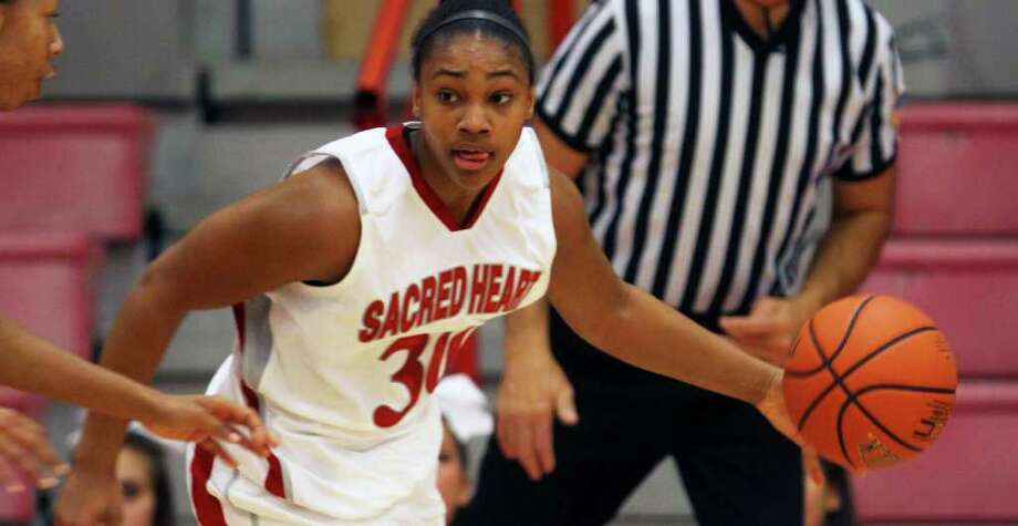 Gabby Washington handles the basketball for Sacred Heart. She and the Pioneers have high hopes headed into the postseason. Photo: Contributed Photo / Connecticut Post Contributed
