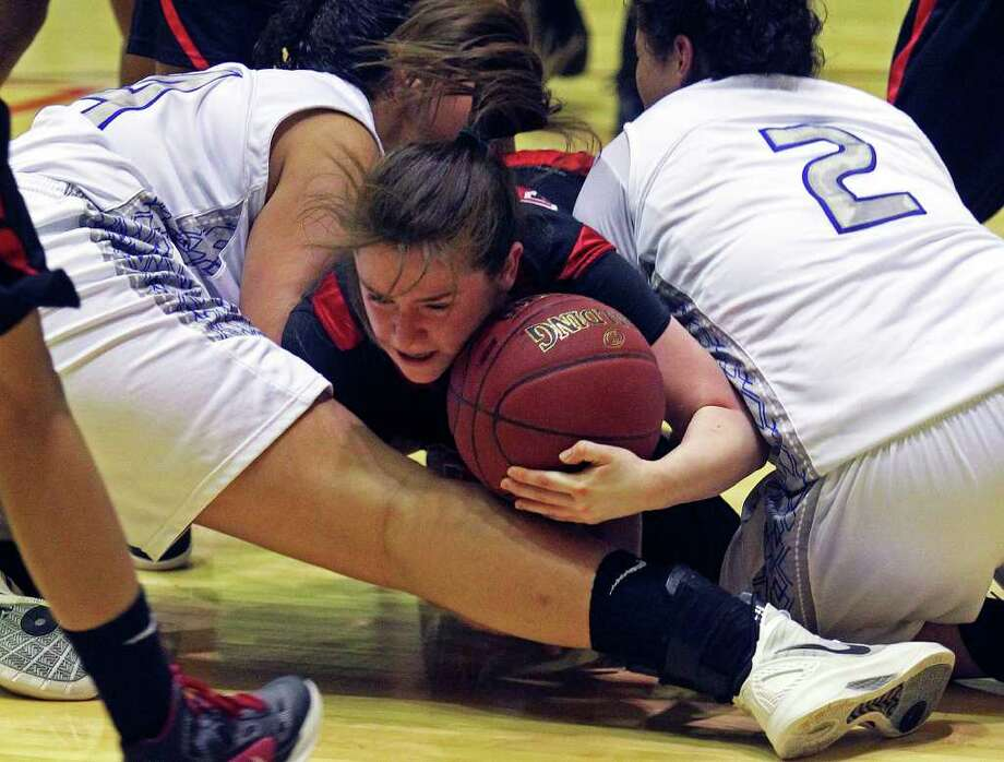 Thunderbird guard Corrina Moncada dives into a pile and steals the ball in the fourth quarter as Wagner defeats Jay in girls playoff basketball action at Littleton Gym  on February 17, 2012 Tom Reel/ San Antonio Express-News Photo: TOM REEL, Express-News / San Antonio Express-News