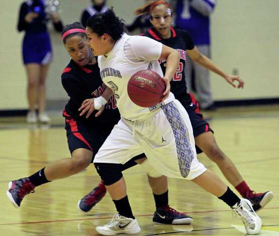 Destiny Amezquita handles the ball in the final minute for the Mustangs as Ashley Ross tries to foul and stop the clock as Wagner defeats Jay in girls playoff basketball action at Littleton Gym  on February 17, 2012 Tom Reel/ San Antonio Express-News Photo: TOM REEL, Express-News / San Antonio Express-News
