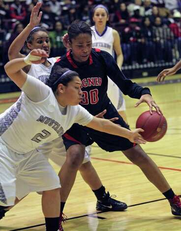 Mustang defender Destiny Amezquita darts under a posting Tesha Smith trying to get a steal as Wagner defeats Jay in girls playoff basketball action at Littleton Gym  on February 17, 2012 Tom Reel/ San Antonio Express-News Photo: TOM REEL, Express-News / San Antonio Express-News
