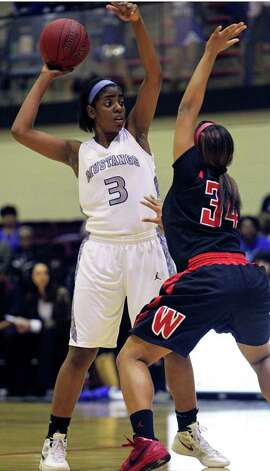 Mustang post Aleeya Harris works the ball up high against Ashley Dunn as Wagner defeats Jay in girls playoff basketball action at Littleton Gym  on February 17, 2012 Tom Reel/ San Antonio Express-News Photo: TOM REEL, Express-News / San Antonio Express-News