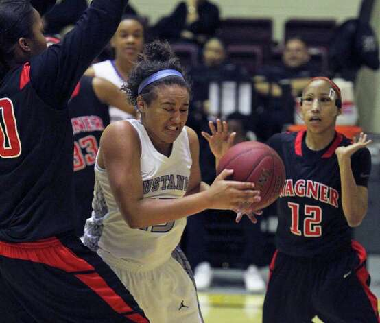 Mustang forward Katelyn McCullar moves into the defense of Tesha Smith as Aundrea Davis looks on as Wagner defeats Jay in girls playoff basketball action at Littleton Gym  on February 17, 2012 Tom Reel/ San Antonio Express-News Photo: TOM REEL, Express-News / San Antonio Express-News