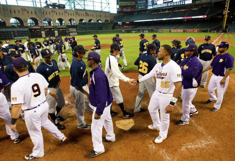 Prairie View and Southern players shake hands at the end of their game during The Urban Invitational college baseball round-robin tournament at Minute Maid Park Friday, Feb. 17, 2012, in Houston. Southern beat Prairie View 6-0. ( Brett Coomer / Houston Chronicle ) Photo: Brett Coomer / © 2012 Houston Chronicle