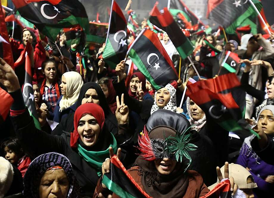 Libyans wave their new national flag as they celebrate the first anniversary marking the start of the uprising against the former regime in Tripoli on February 17, 2012. Libyans celebrated the first anniversary of the uprising that ousted Moamer Kadhafi with fireworks and slogans, even as their new leader vowed to prevent further instability. Photo: Mahmud Turkia, AFP/Getty Images