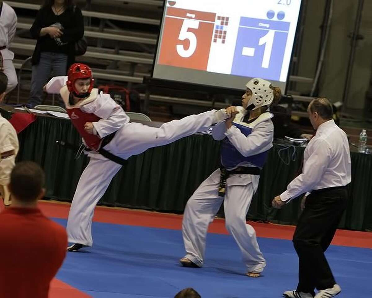 Danielle Gay of Rhinebeck competes in a taekwondo qualifer at Hudson Valley Community College on Feb. 4. She won the adult division as a junior.
